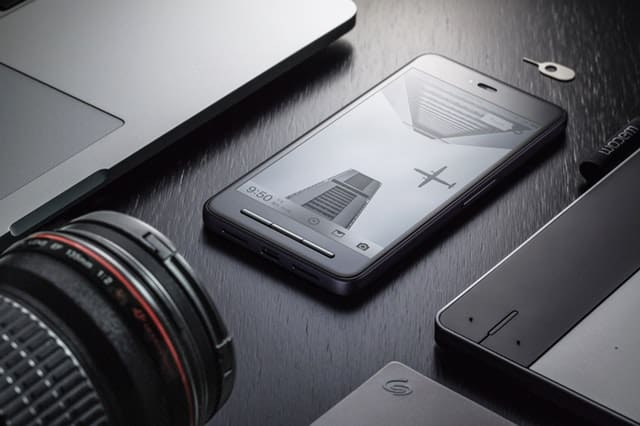 Phone, laptop, and camera lens