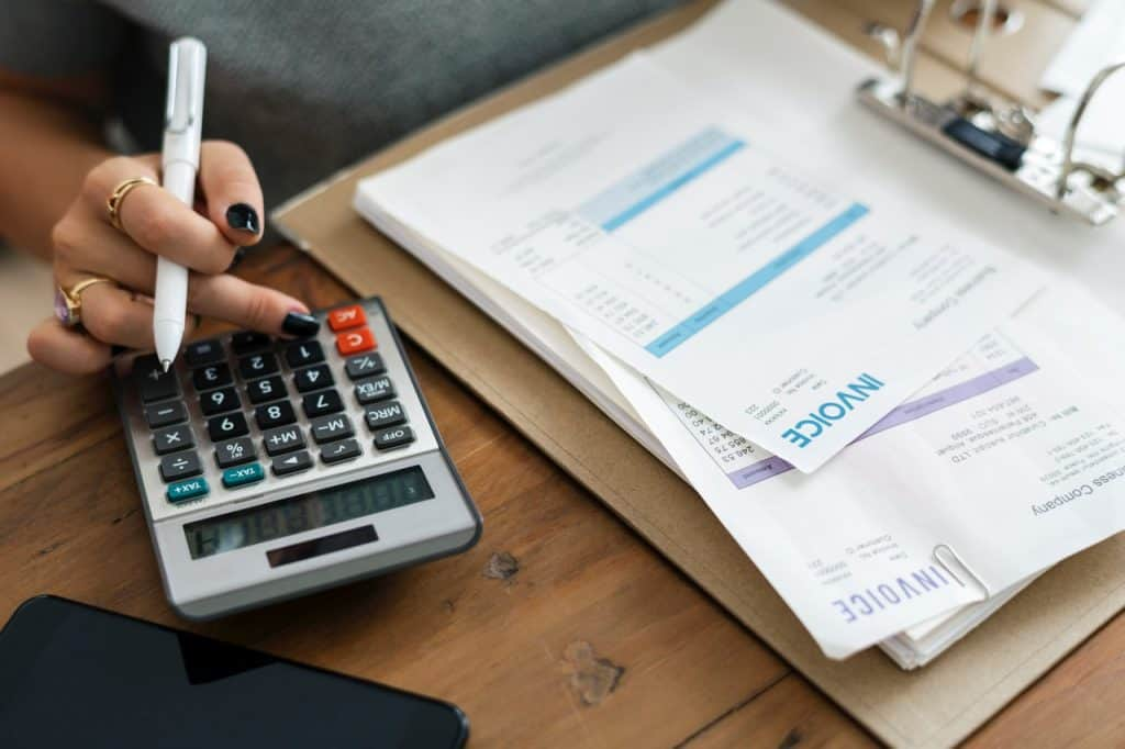 woman with calculator and invoices