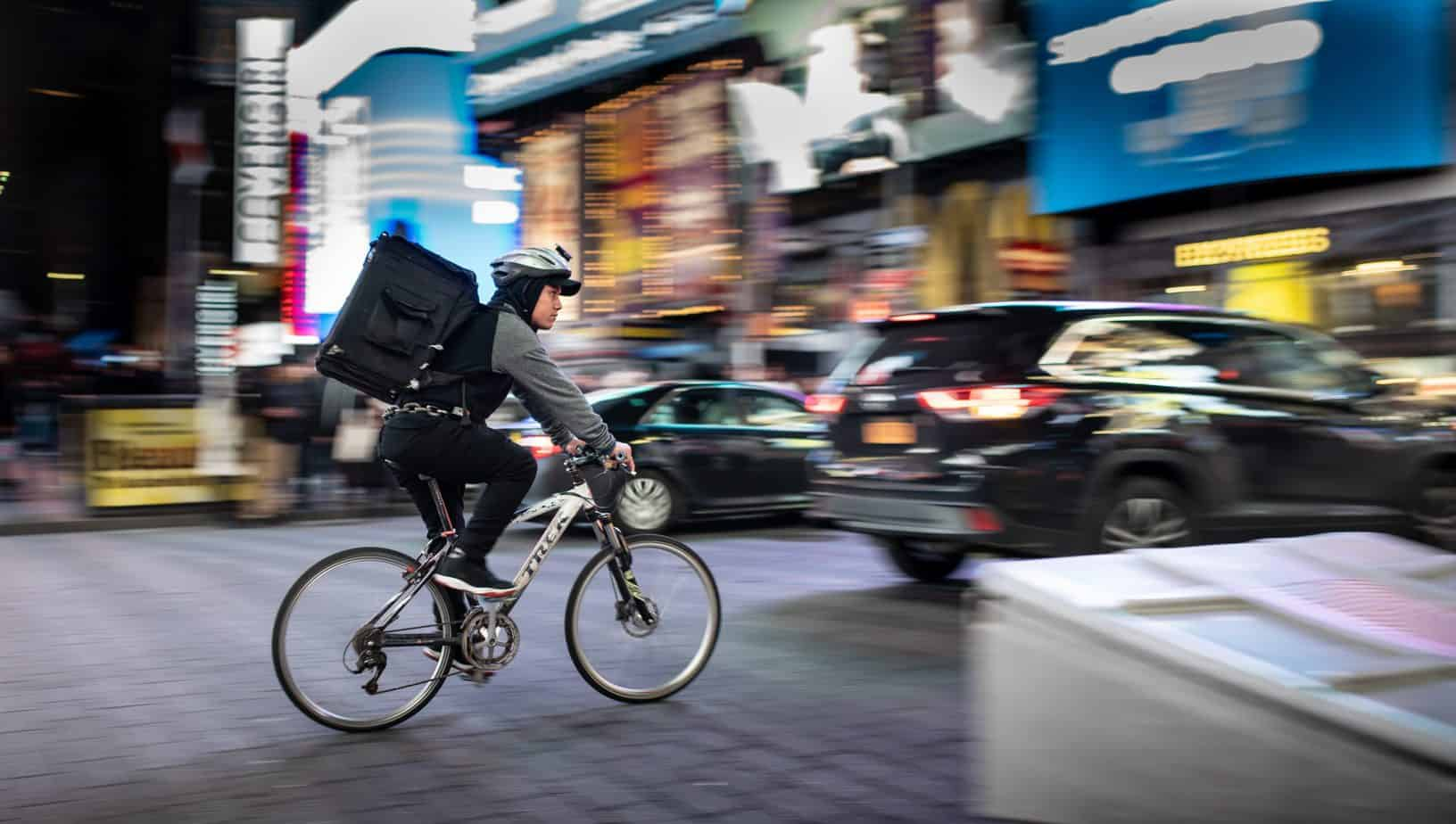 Man on bicycle delivering food